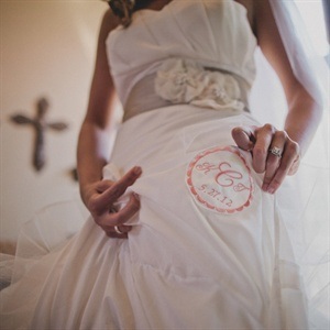 Kelsey's mom helped her make the belt she wore with her ivory wedding dress using raw silk and handmade organza flowers.