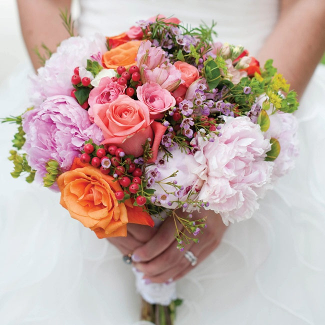 Brandi carried a ruffled mix of roses, peonies and hypericum berries.