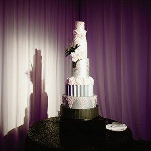 The seven-tiered cake was actually inspired by Kelly's gown - each tier represented a different design element.