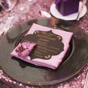 Pink napkins were topped with laser-cut, silk-screened menu cards tat mimicked the invitation design.