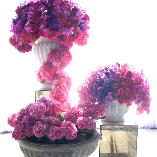 Pink and purple hydrangea-, orchid- and rose-filled vases framed the spot where the couple exchanged vows.