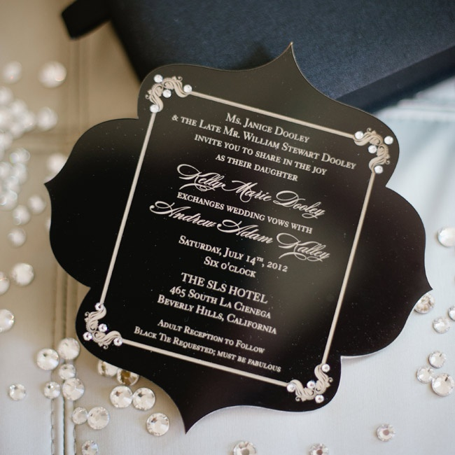 Black, laser-cut acrylic invitations were finished with a luxe gold font.