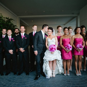 The bridesmaids wore raspberry-colored dresses, while the guys matched in black suits and pink ties.