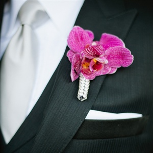 Andrew wore a fuchsia orchid on his lapel.