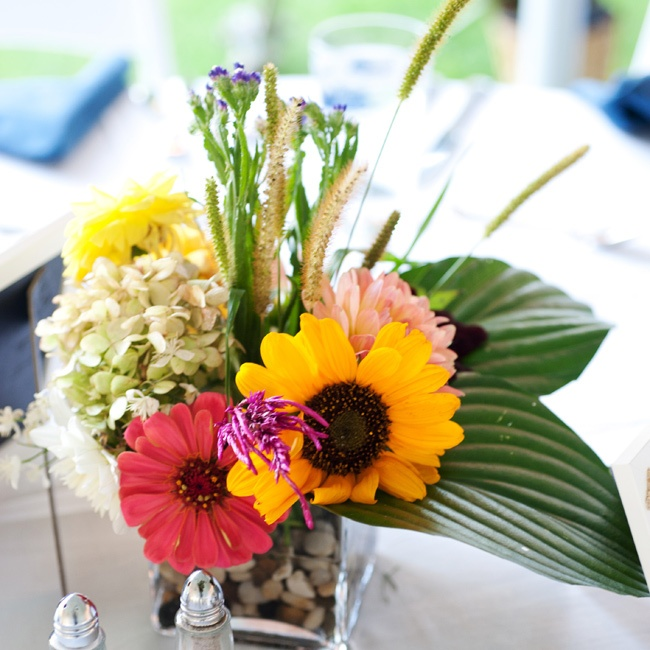 Hand-picked flowers were arranged in glass vases of all sizes by Nathaniel's mom and her friends.