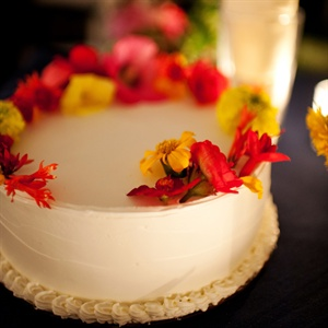 The couple's individual cake was topped with buttercream frosting and garnished with edible flowers.