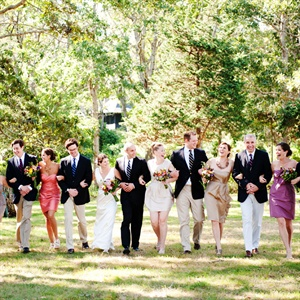 The bridesmaids chose dresses in silhouettes that flattered them in neutral, fall colors, while the guys wore blue blazers and their own khakis.