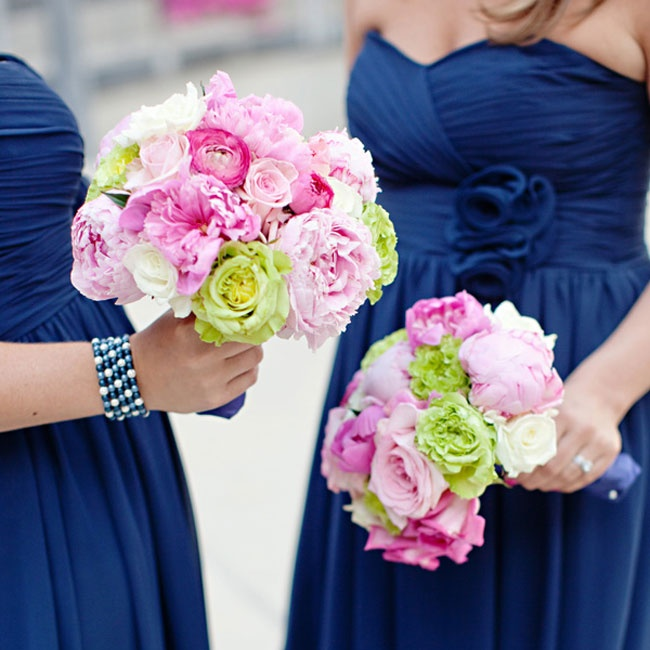 The Bridesmaids bouquets were very similar to that of the bride's but they had a brighter pink hue to make them stand out.