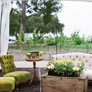 To create a vintage vibe in the reception tent, plush armchairs, sofas, side tables and eclectic items made up mini lounges.