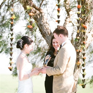 Rain chains filled with little flowers hung from the tree Alyssa and Ben exchanged vows under.