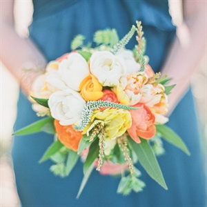 The bridesmaids carried smaller versions of Alyssa's bright bouquet, with tulips, roses and ranunculus.