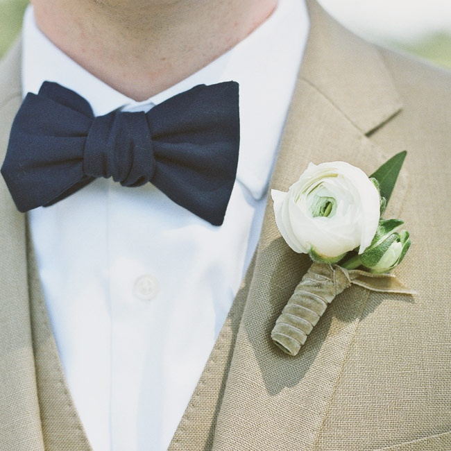 Ben wore a khaki-colored suit with a navy bow tie and a white ranunculus bloom.