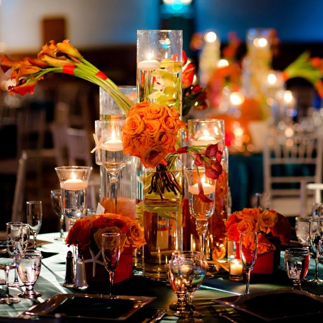 High and low centerpieces were filled with manzanita branches, roses and orchids.