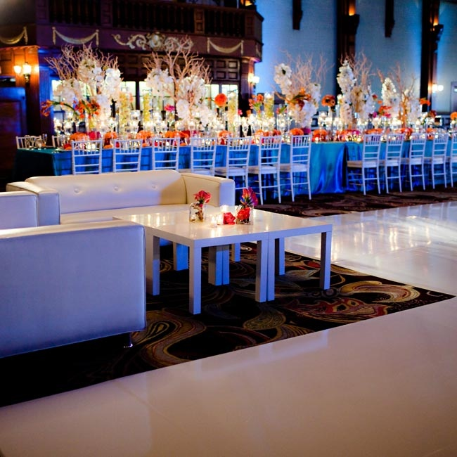 Luxe white-leather couches were set up around the dance floor so guests could take a break from dancing.
