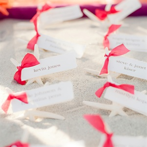 The escort cards were tied to starfish and displayed in sandboxes.