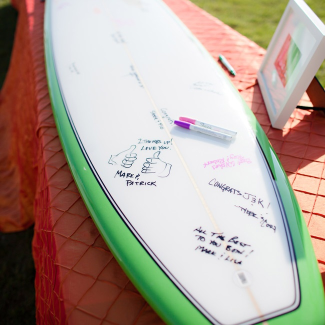 Instead of a traditional book, guests signed a surfboard.