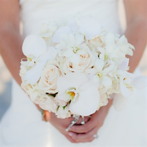 Kelsey carried an all-white bouquet of orchids, roses and gardenias.