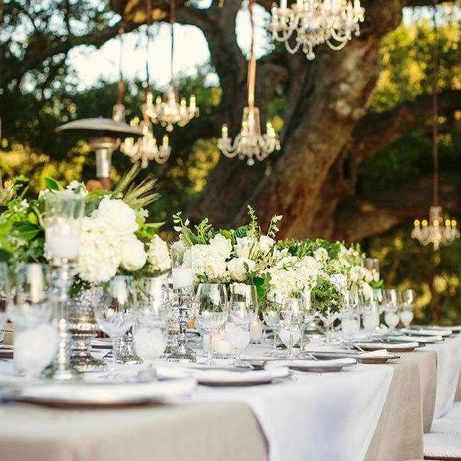 Originally, Lacey and Charlie wanted to marry under this giant oak on the property. Ultimately, they decided it would be an amazing reception spot; perfectly placed white and green flowers set the scene.