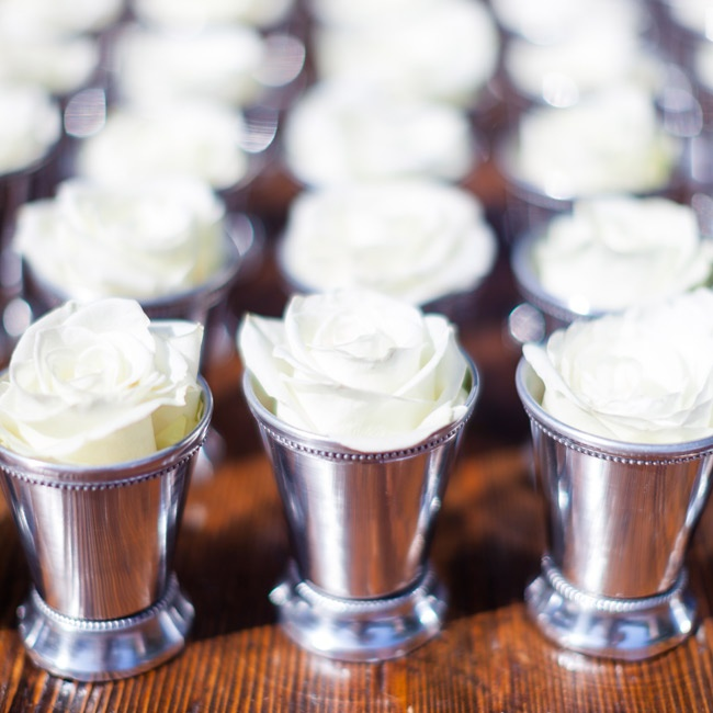 Guests took mint julep cups filled with white rose petals and tossed them at the couple as they exited the ceremony space.