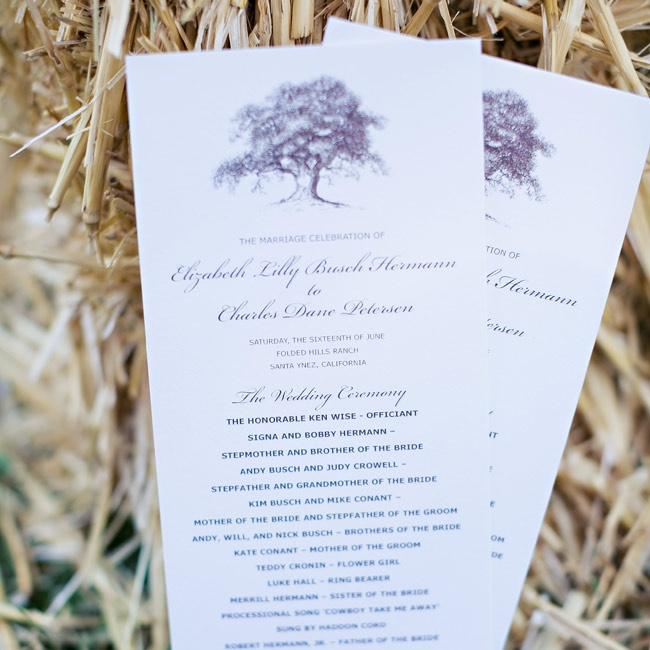 The tea-length programs featured the couple's oak tree motif at the top.