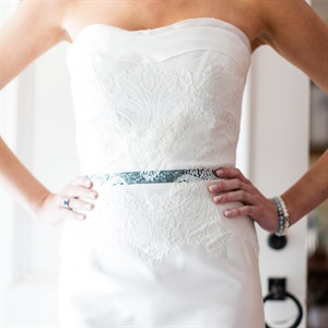 "After months of indecision, Lacey tried on this dress and knew it was ""the one."" The lace-wrapped bodice and black ribbon peeking through the material made it a perfect fit for the day's ranch-chic vibe."