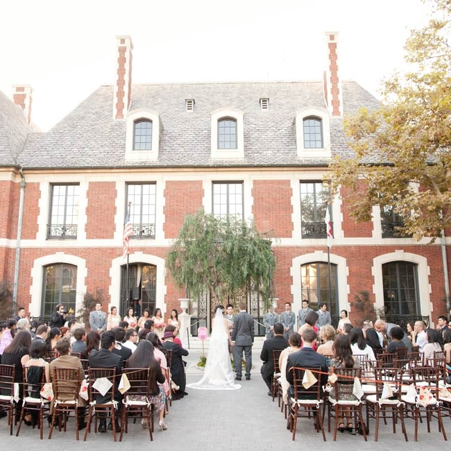 The couple wed in the estate's courtyard; a tree served as the altar backdrop.