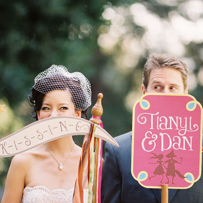 The two flower girls carried these playful signs down the ceremony aisle.