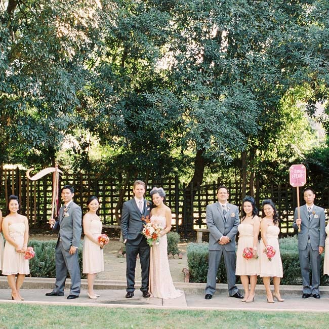 While the bridesmaids wore lightweight cream dresses, the guys chose classic gray suits.