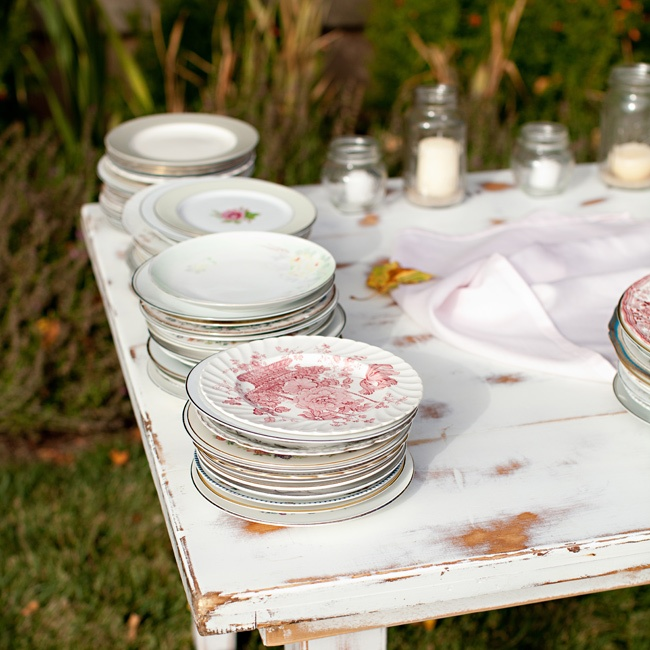 The couple collected various vintage china for the dessert table for a unique, mixed look.