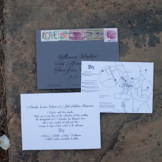 Brooke actually designed the couple's wedding invitations! They included a custom map of the area and she collected vintage stamps for the envelopes.