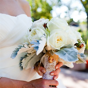 "Brooke carried her ""something old"" on her bouquet -- her grandmother's brooch. White roses and dusty miller gave the bunch a vintage look."
