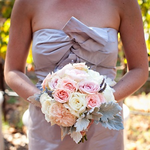 The bridesmaids carried bunches of garden and spray roses, dusty miller and lavender.