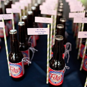 The groom's last name, Fitzsimmons, was the inspiration for the wedding favors, Fitz's Root beer bottles that doubled as escort cards. They continued the Fitz's theme by offering a variety of Fitz's beverages at the bar.