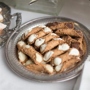 Instead of a wedding cake, Celeste and Brian served their favorite dessert, cannoli.
