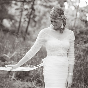 For a soft and delicate look on her wedding day, Celeste, wore a Monique Lhuillier gown in ivory tulle which was accented with a tulle belt that was embroidered and had beading.