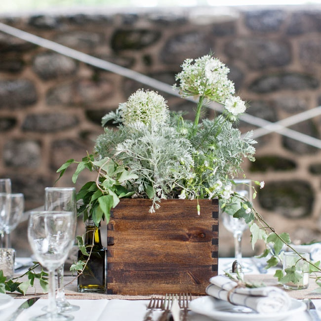 Along with floral arrangements these wooden boxes filled with a mixture of live plants and fresh cut flowers gave the tables a rustic appeal.