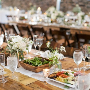 The natural elements of the decor on the rustic farm tables with lace table runners gave the reception room a rustic feel.