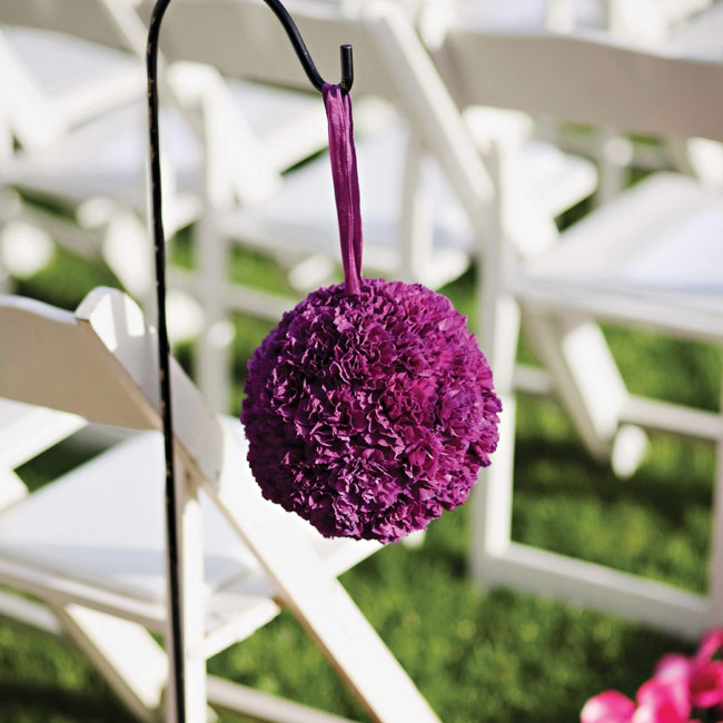 Deep-purple pomanders lined the ceremony aisle.