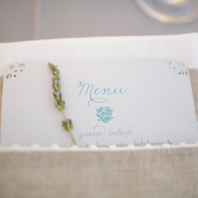 A soft-blue font decorated the menu cards, which were tucked into the napkins along with a sprig of lavender.