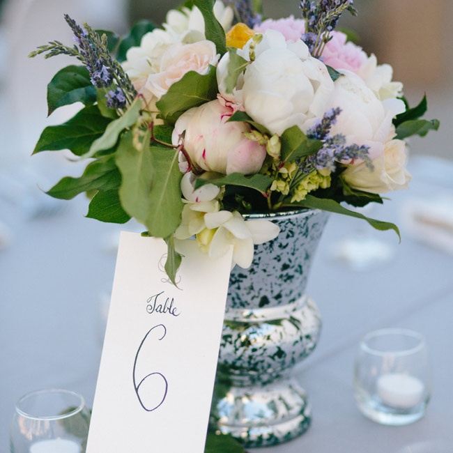 Mercury-glass vases were filled with sprigs of fresh lavender and herbs, and peony and rose blossoms.