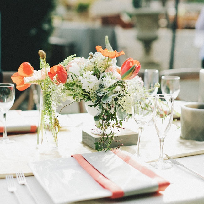 Orange and white blooms decorated the tables to create a just-picked look.