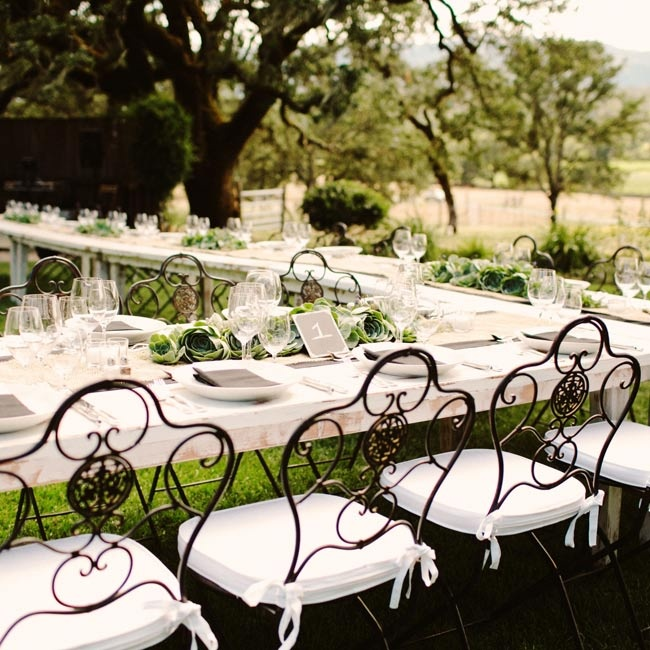 White farm tables made ideal blank canvases. Burlap runners were overlaid with Spanish moss and homegrown succulents.