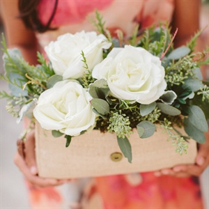 Arlina&#39;s bridesmaids carried unique burlap fabric clutches filled with overflowing rosemary and sage as well as white roses.