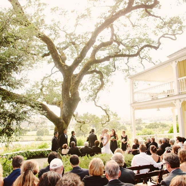 The couple exchanged vows beneath a giant blue oak overlooking the striking vineyards of Sonoma Valley.