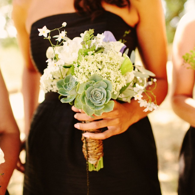 Purple and white sweet peas, roses, potato vine and succulents added texture to the bridesmaid bouquets.