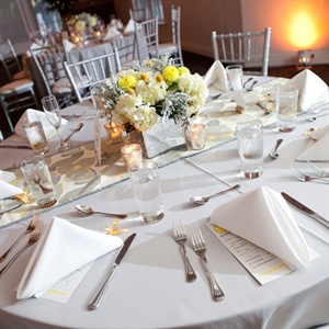 Megan found the gray and yellow leaf fabric online that her mother-in-law used to for the table runners she hand made. The table runners sat on top of gray tablecloths for a classic look.