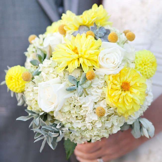 Megan is not a fan of roses so she knew she didn't want to use too many of them for her bouquet. Her bouquet was a combination of white hydrangeas, silver hen and chicks, and yellow caspedias with a few white roses for accents.