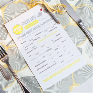 The bride and groom placed mad libs wedding edition at every place settings asking their guests for marriage advice.