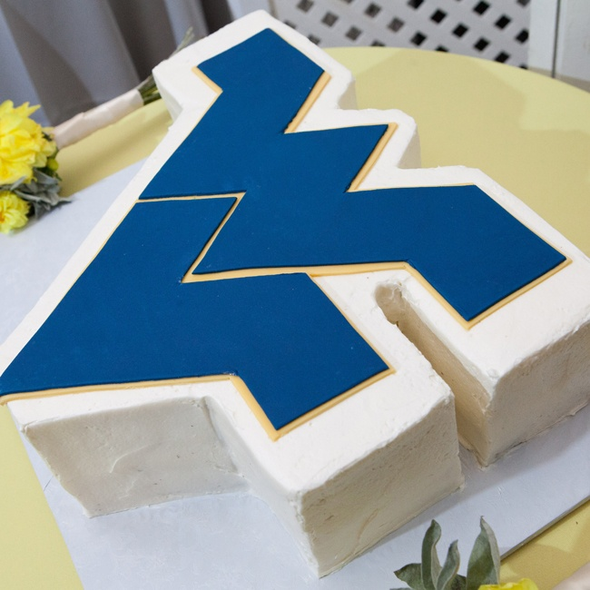 Megan surprised PJ with a WVU grooms cake that represented the University he attended