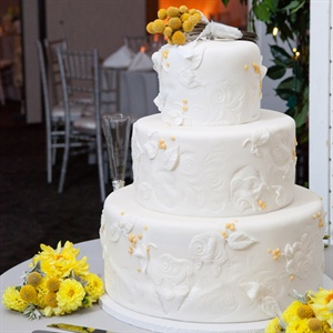 Megan and PJs wedding cake was a red velvet three tier wedding cake with a leaf design on each layer that resembled the design on the fabric the table runners were made of.